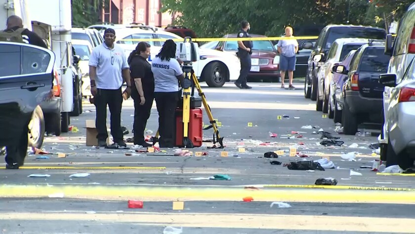 In this image from video, law enforcement work the scene of a shooting Sunday in Washington, D.C.