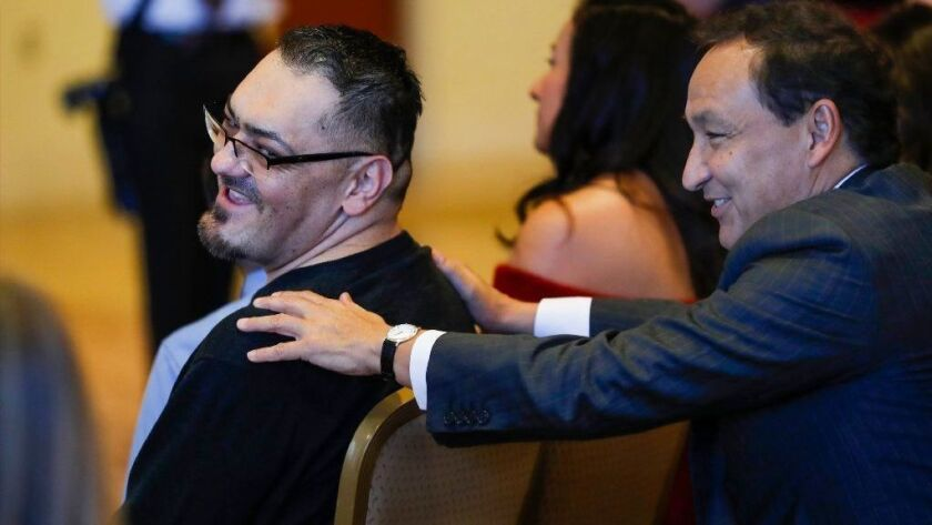 Oscar Munoz, right, CEO of United Airlines, who received a heart transplant in January 2016, talks with 2018 heart transplant recipient Juan Deleon after Deleon spoke at a news conference at Northwestern Medicine Prentice Women's Hospital on Dec. 17, 2018.