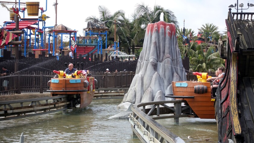 """Riders can spray water at other boats and people on shore in """"Splash Battle,"""" an interactive ride at Legoland."""