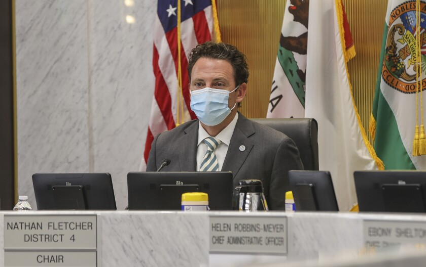 Chair of the County Board of Supervisors Nathan Fletcher wears a mask at a board of supervisors meeting in May