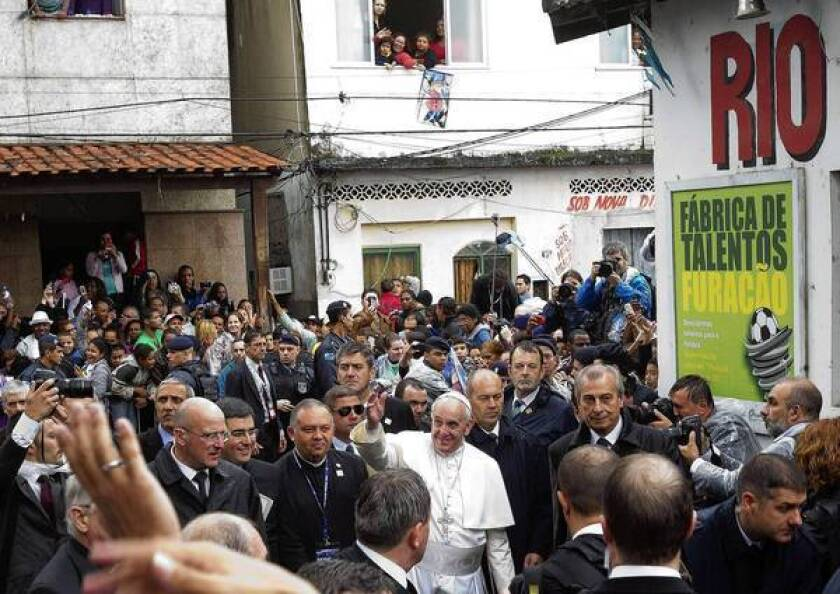 Pope Francis visits a Brazil slum, scolds country's leaders