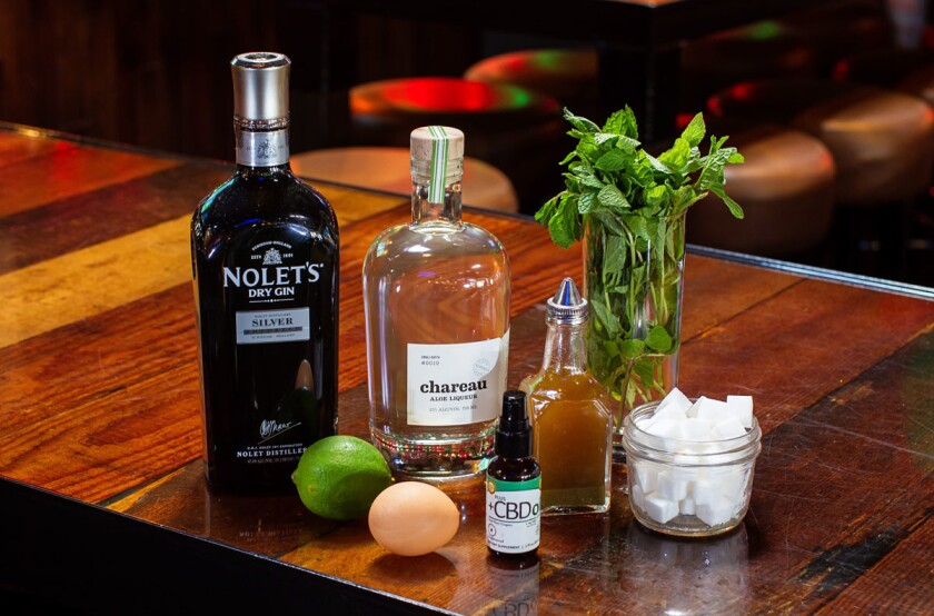 "Ingredients for ""Prop. 64"" drink by bartender Daniel Sutherland at True North in San Diego include Nolet's Dry Gin, Chareau Aloe Liqueur, CBD cannabis oil, house made mint amarillo dry hopped bitters, an egg white, lime juice, sugar. (Eduardo Contreras/U-T)"