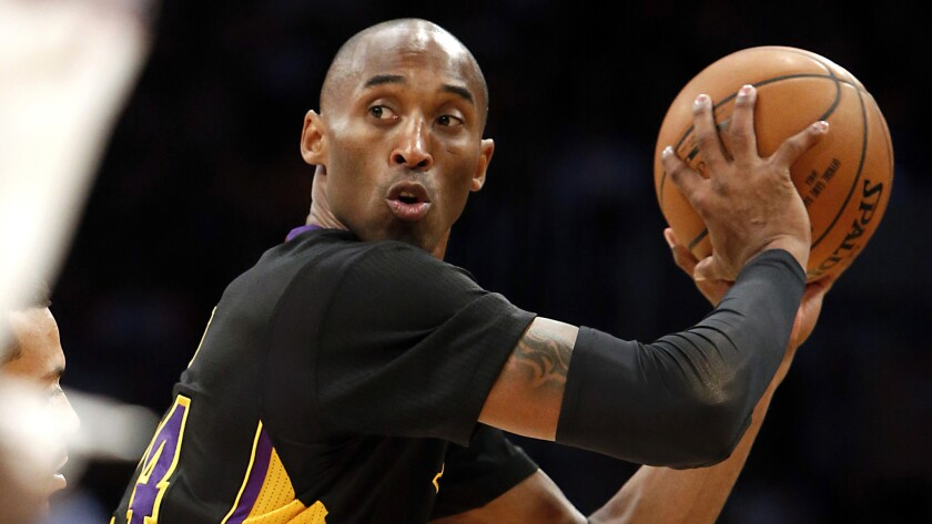 Lakers star Kobe Bryant looks to pass during a game against the Clippers in 2013.