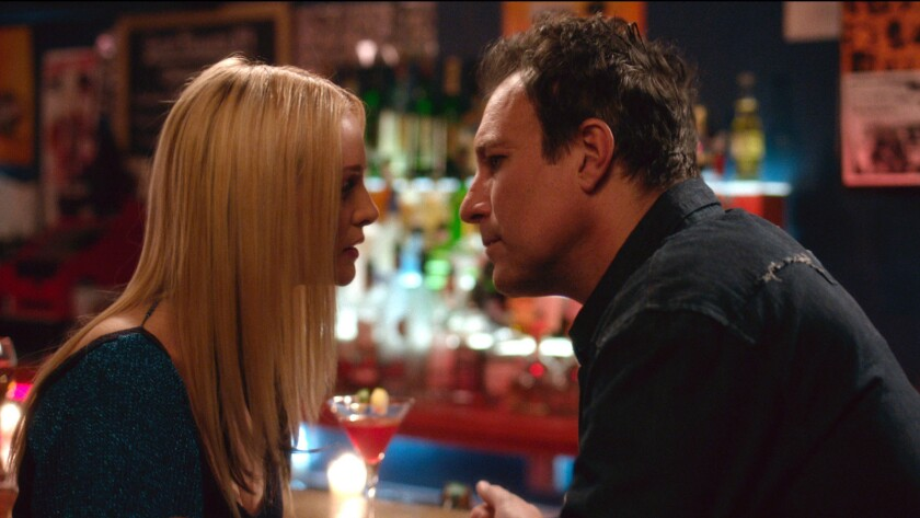 "Heather Graham and John Corbett in the movie ""My Dead Boyfriend."""