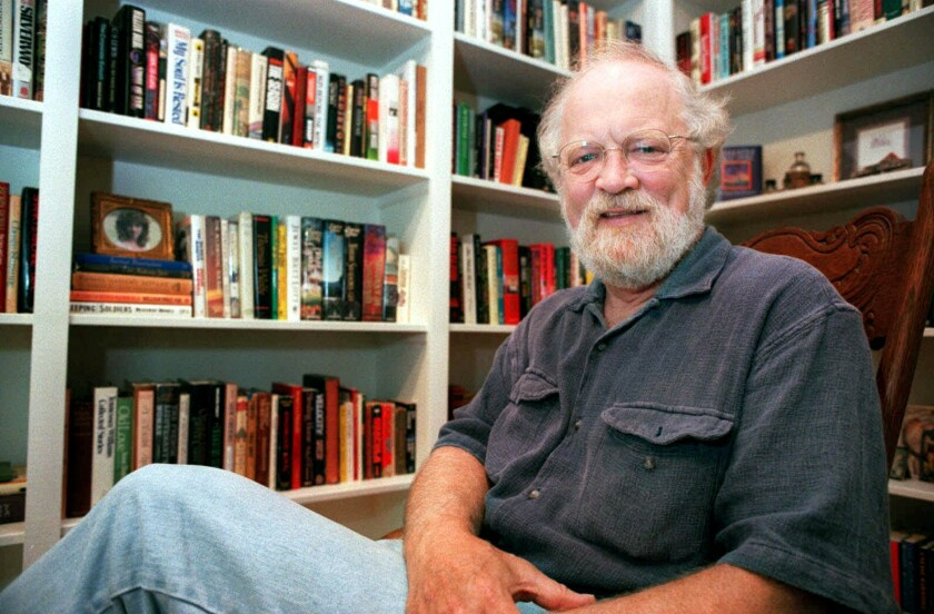 FILE- In this Aug. 1, 1997 file photo, author Terry Kay poses in his home in Athens, Ga. Kay, a native of Georgia who won fans at home and abroad with his novels set in the South, died Saturday, Dec. 12, 2020. He was 82. (Todd Bennett/Athens Banner-Herald via AP, File)