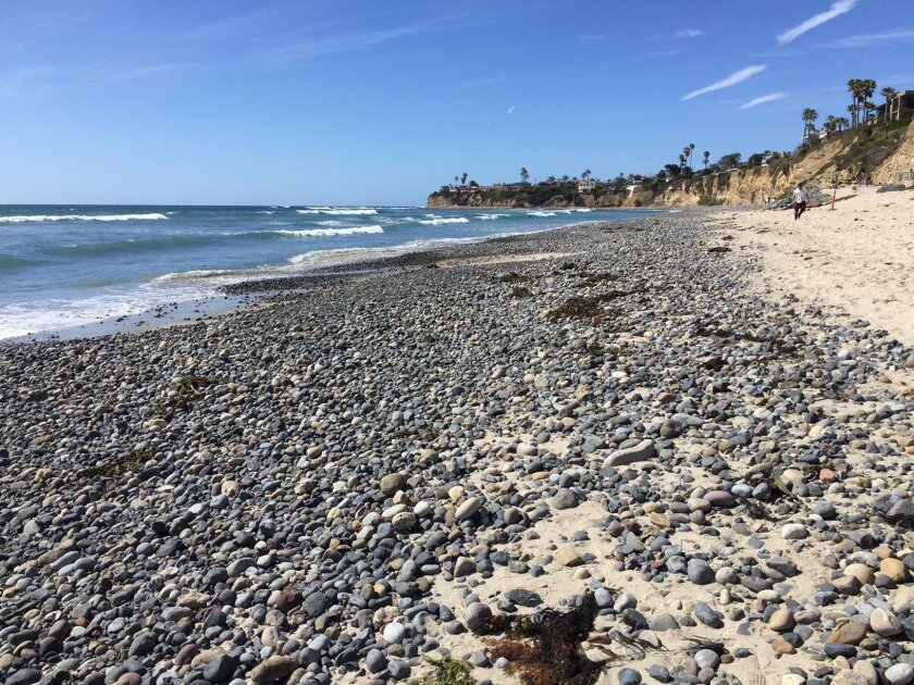 Rocks have taken over the beach walk path along North Pacific Beach.