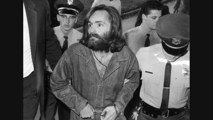Charles Manson is escorted to court for preliminary hearing in 1969.