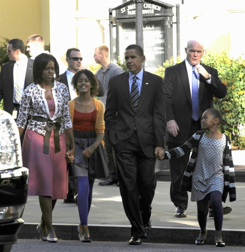 FILE- In this Oct. 11, 2009 file photo, Secret Service Agent Joseph Clancy, right, walks behind President Barack Obama, first lady Michelle Obama and their, children Sasha, right, and Malia, second from left, walk back to the White House after attending St. John's Episcopal Church in Washington. Secret Service Director Julia Pierson resigned Wednesday, a day after bitingly critical questioning by Congress about a White House security breach. There had been increasing calls for her departure during the day. Pierson will be replaced by Clancy, a former special agent in charge of the president's protective detail who retired in 2011. (AP Photo/Susan Walsh, File)