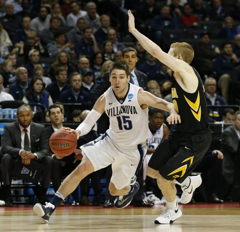 Villanova guard Ryan Arcidiacono (15) drives around Iowa guard Mike Gesell (10) during the second half of a second-ound NCAA men's college basketball tournament game, Sunday, March 20, 2016, in New York. Villanova defeated Iowa 87-68. (AP Photo/Kathy Willens)