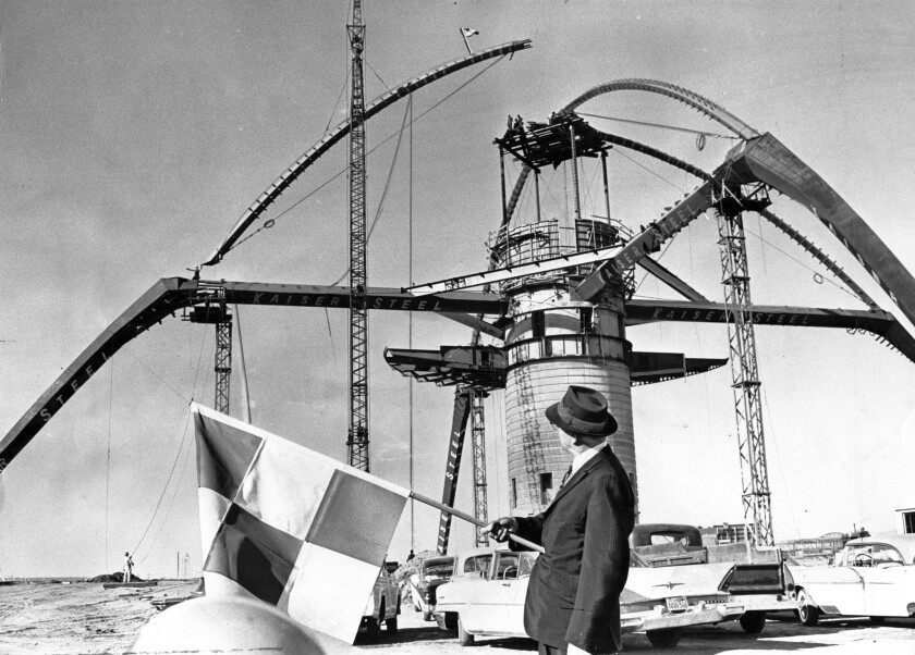 The last girder is placed on the arch of the LAX Theme Building, designed by architect Paul Revere Williams.