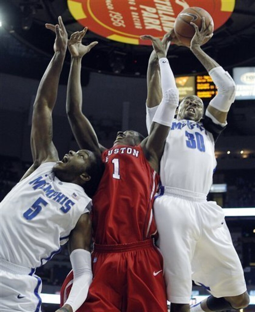 Houston forward Mikhail McLean (1) fights for a rebound against Memphis defenders D.J. Stephens (30), and Shaq Goodwin (5) during the first half of an NCAA college basketball game on Wednesday, Feb. 20, 2013, in Memphis, Tenn. (AP Photo/Lance Murphey)