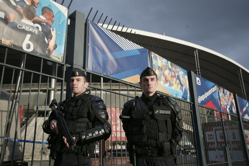French police officers stands guard outside the Stade de France stadium prior to the international friendly soccer match between France and Russia in Saint Denis, north of Paris, France, Tuesday, March 29, 2016. (AP Photo/Thibault Camus)