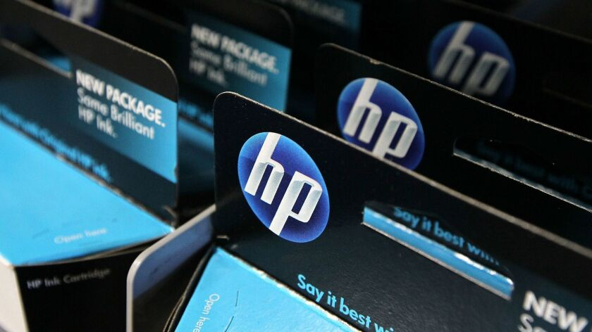 FILE: Shares of Hewlett-Packard Tank After Asset-impairment Charge
