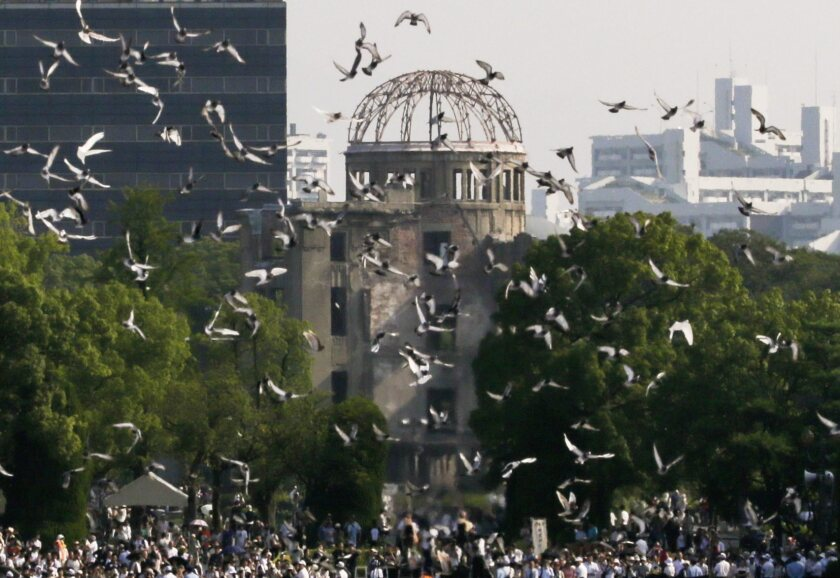 At Hiroshima Peace Memorial Park in Japan, doves fly over the atomic bomb dome during a 2015 ceremony marking the 70th anniversary of the atomic bombing.