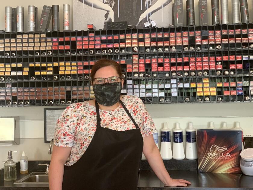 Business has rebounded at Tamara Ybarra's salon in Oshkosh, but she worries that the coronavirus still poses a threat.