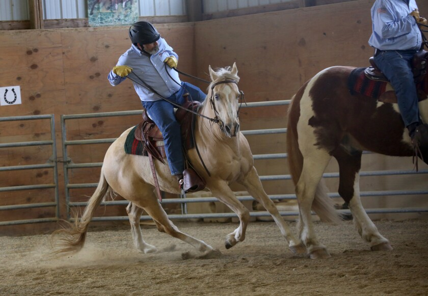 Veteran Ron Hathaway rides Wyatt, who BraveHearts workers say was abused and can be easily startled.