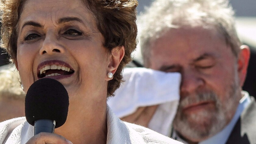 Brazilian President Dilma Rousseff speaks to supporters Thursday morning outside the Planalto Palace in Brasilia. She was successor of former President Luiz Inacio Lula da Silva, who stands behind her.