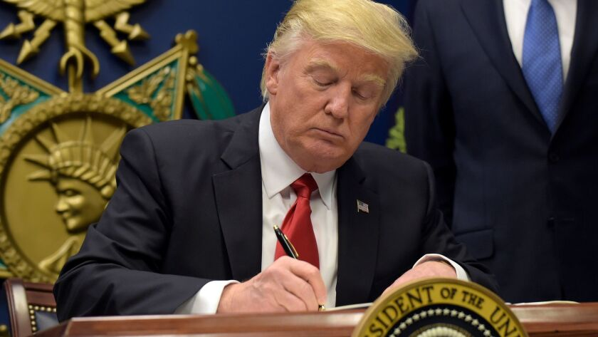 President Trump signs his executive order on immigration.