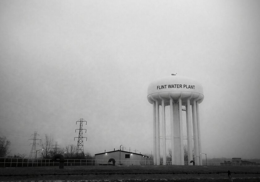 This Jan. 21, 2016 photo shows the water tower at the Flint, Mich., water plant. Flint's mayor has floated a shockingly high price to fix the city's lead-contamination problem, saying it could millions to replace damaged pipes. (Perry Rech/American Red Cross via AP) MANDATORY CREDIT