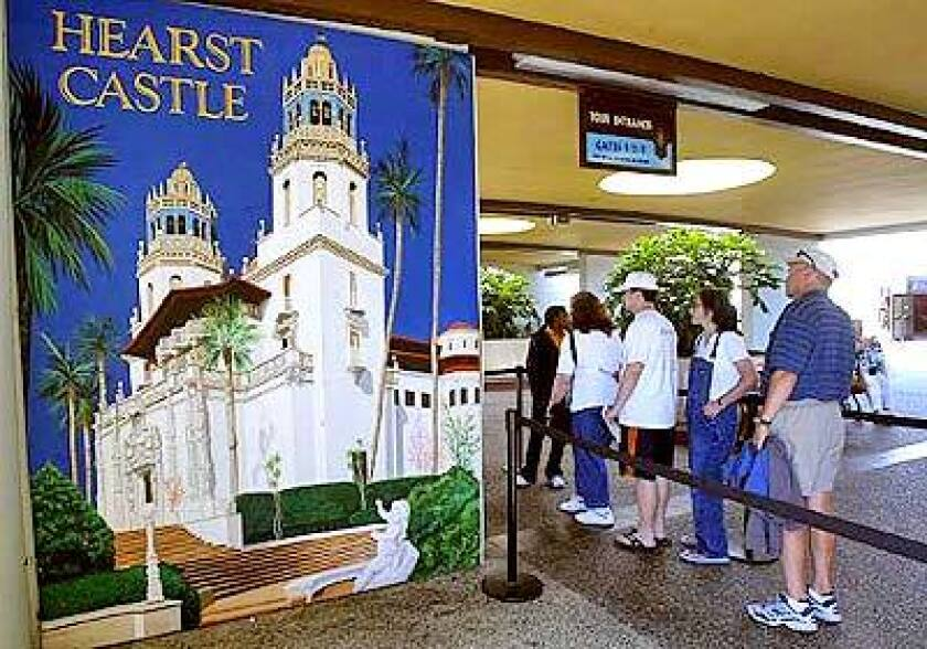 Tourists wait to ride a bus up the hill to tour Hearst Castle in San Simeon on the Central Coast.