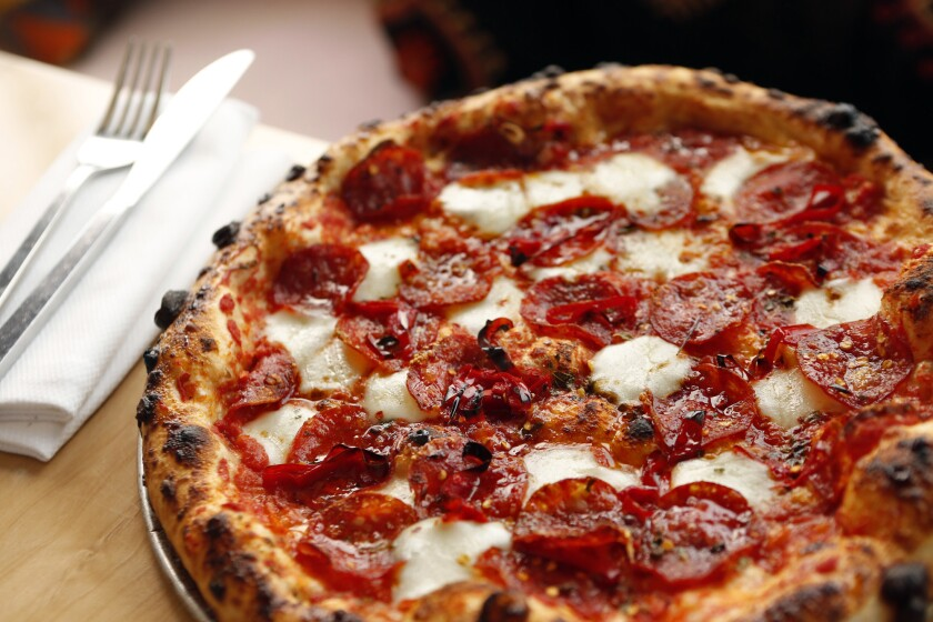The Killer Bee pizza's toppings include pepperoni and honey.