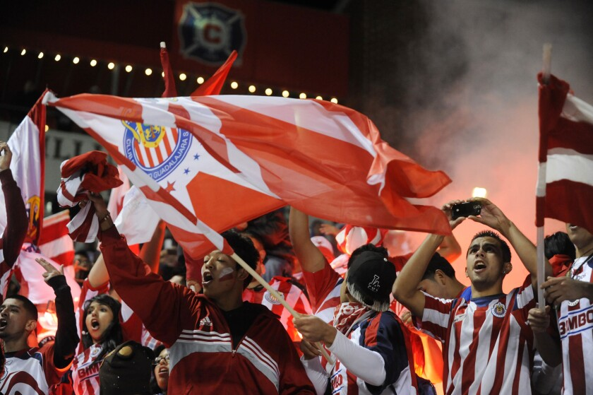 Chivas of Guadalajara fans cheer on their team during an exhibition against the Chicago Fire.