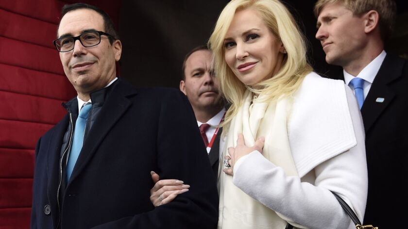 Steve Mnuchin and Louise Linton, who were married June 24, arrive on Capitol Hill for Donald Trump's inauguration as president on Jan. 20.