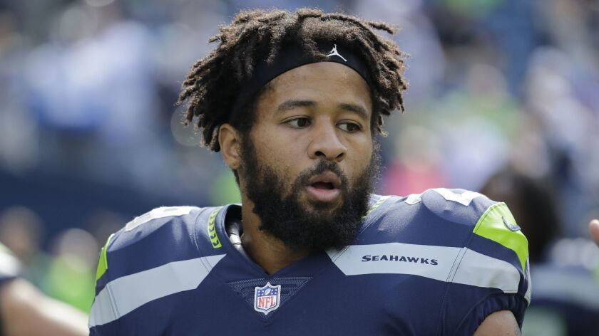 Seattle Seahawks free safety Earl Thomas stands on the field during warmups before an NFL football g