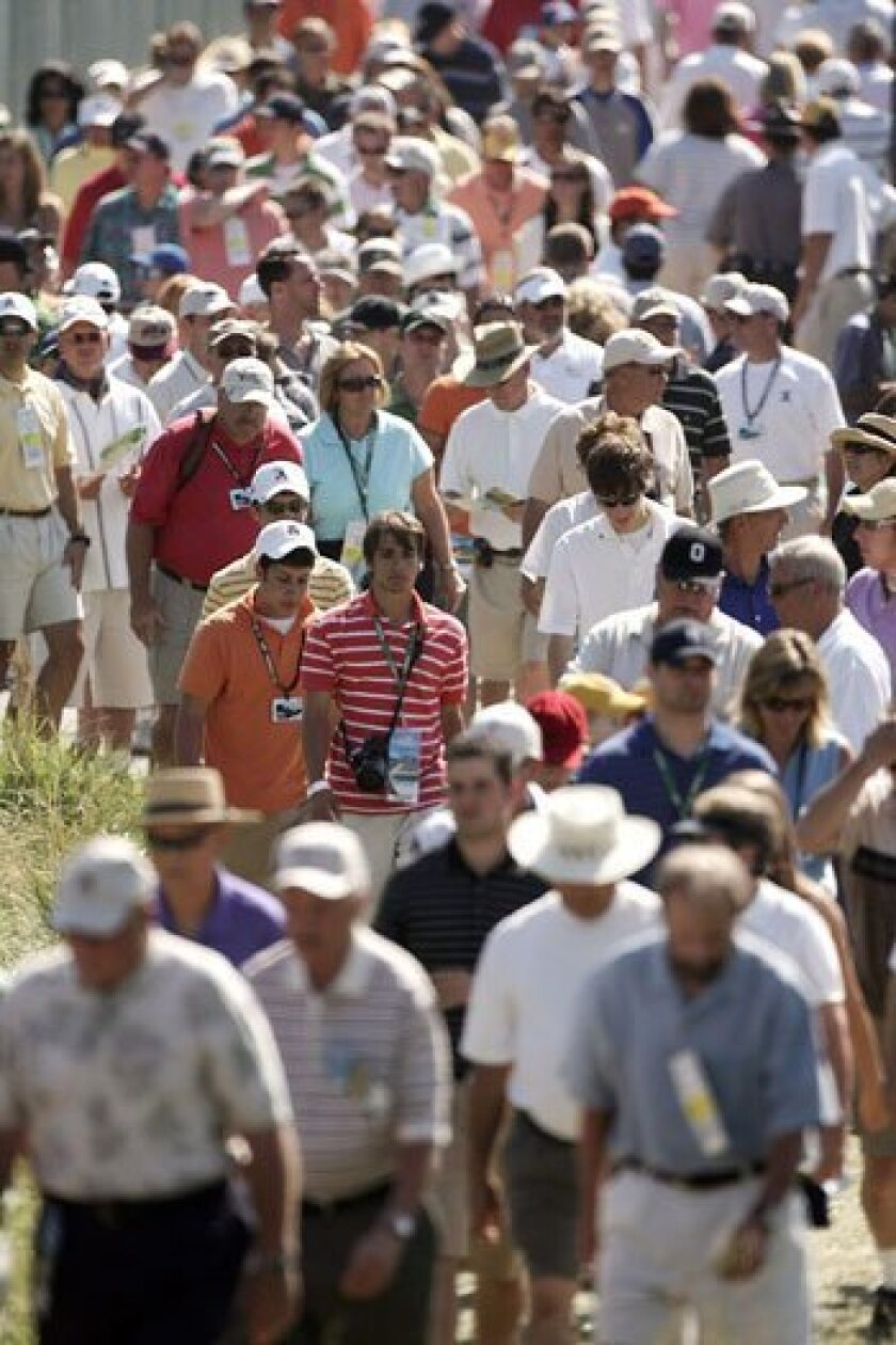 Fans walk between holes at the 2007 U.S. Open in Oakmont, Pa. Large crowds are expected for this year's event as well.
