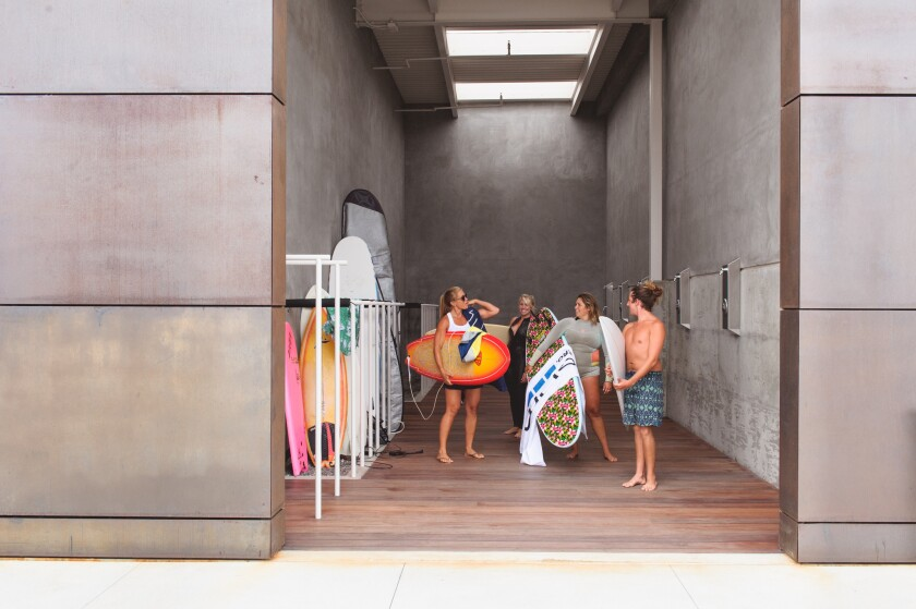 GoPro employees get ready for a lunchtime surf session -- with the boss' approval.