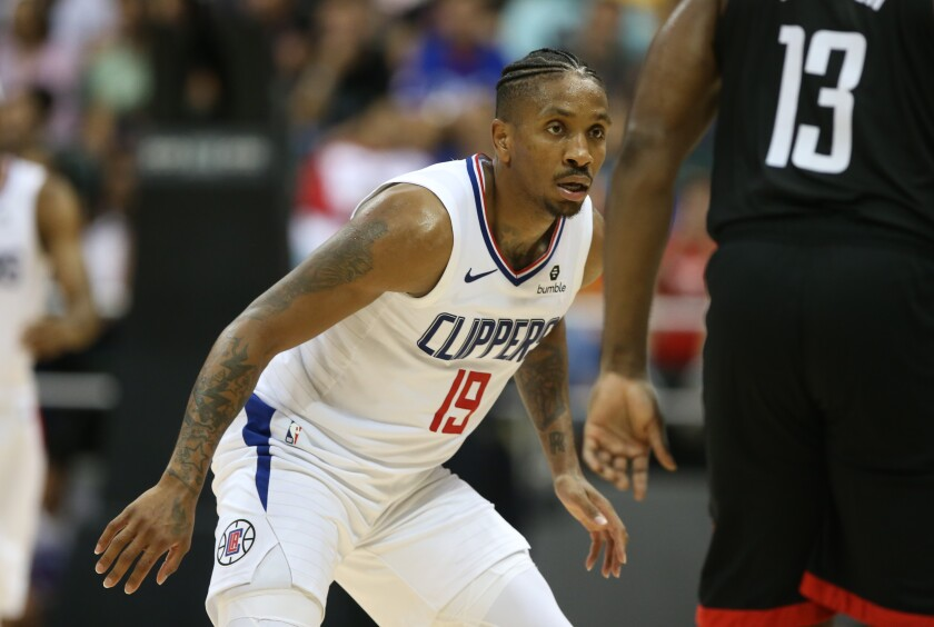 Clippers guard Rodney McGruder prepared to play defense during a game against the Rockets.