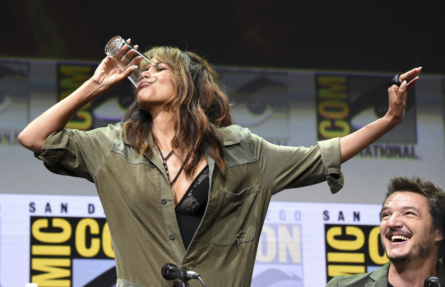 Halle Berry has a drink on stage.