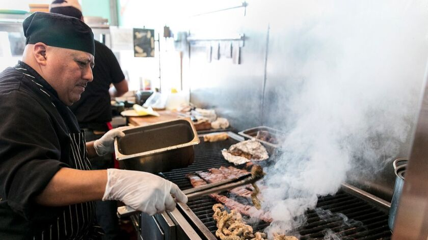 Sonoratown grill master Isaac Aparicio cooks short ribs and beef tripe
