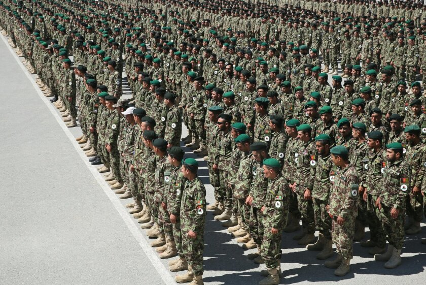 Afghanistan's National Army soldiers stand guard during their graduation ceremony at the Kabul Military Training Center in Kabul, Afghanistan, Sunday, June 1, 2014. (AP Photo/Massoud Hossaini)