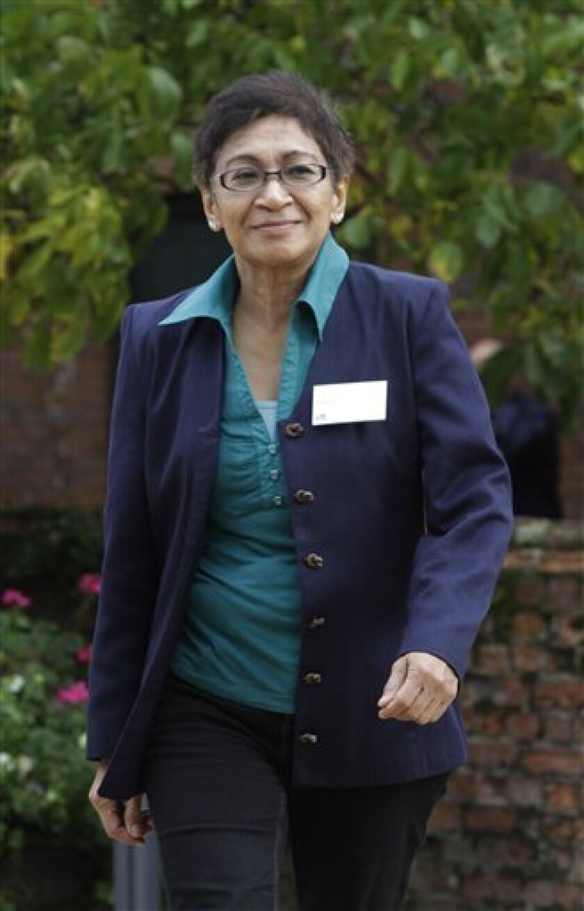 Mazlan Othman, head of the UN's Office for Outer Space Affairs, poses for the Associated Press, outside a Royal Society conference she was attending in Chicheley, England, Tuesday Oct. 5, 2010. Othman, a Malaysian astrophysicist, said it would make sense for the United Nations and its member states to be studying the important question of who should represent humanity if aliens do come to this planet. (AP Photo/Lefteris Pitarakis)