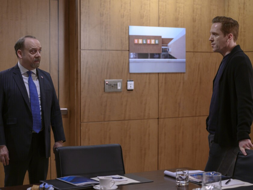 "Paul Giamatti, left, and Damian Lewis in ""Billions."""