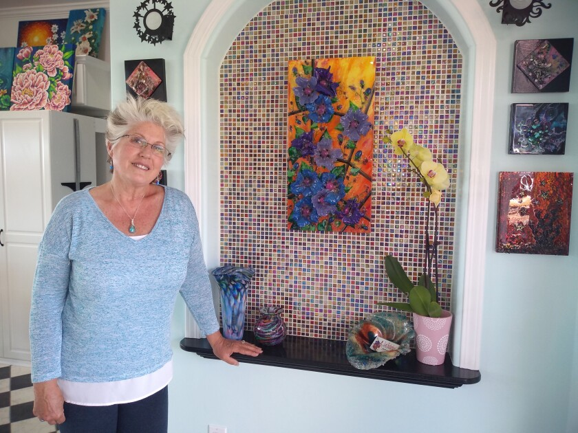 Lori Sutherland makes colorful serving trays, cutting boards and coasters with resin and stones.