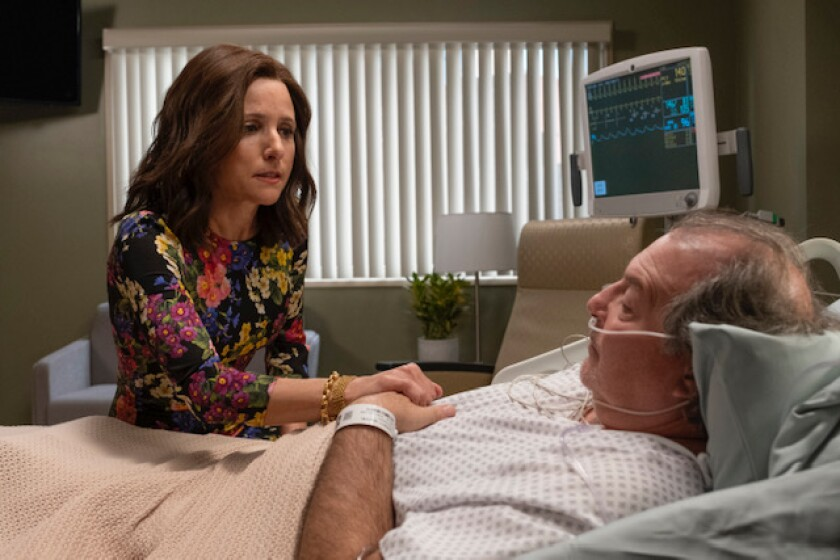 "Julia Louis-Dreyfus' ""Veep"" character consoles Ben, played by Kevin Dunn, in a hospital bed."