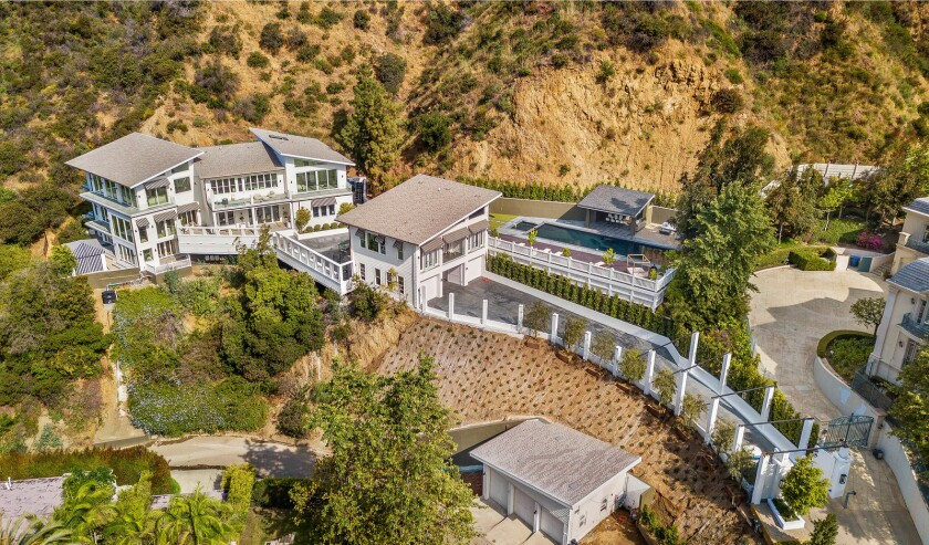 Set in the foothills of the Santa Monica Mountains, the two-acre estate holds a 13,000-square-foot home, a guesthouse and a 70-foot swimming pool.