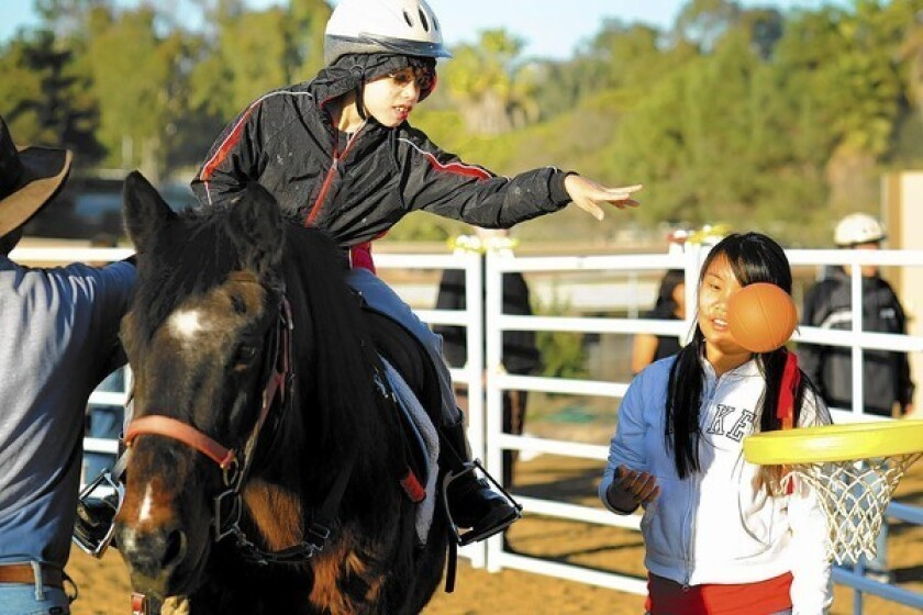 The Assistance League offers scholarships to the Therapeutic Riding Center of Huntington Beach and allows disabled children a chance to ride horses. It is one of 15 programs the Assistance League participates in.