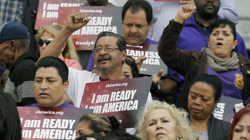 Community activists rally for programs that defer deporations during a Los Angeles event in February.