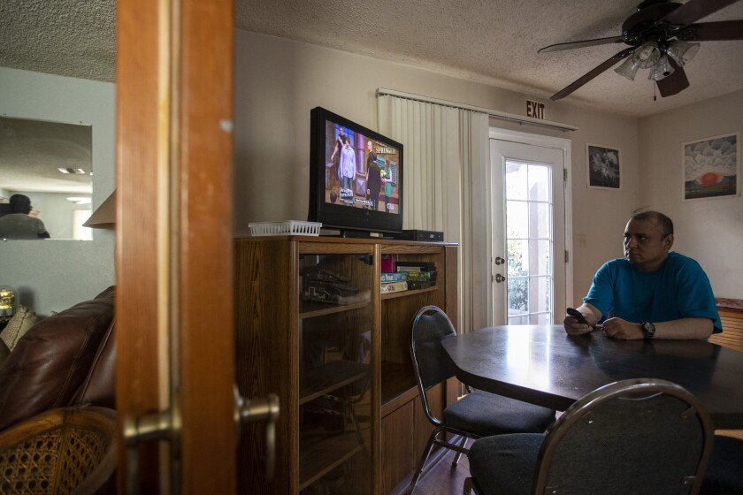 "Louie Villalva, an eight-year resident of the Blake Home in Sylmar, watches ""The Jerry Springer Show."" Funding problems could cause the board-and-care home, and many others like it, to close."