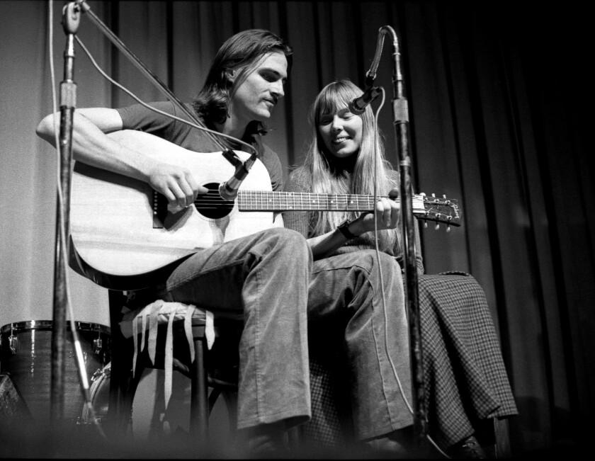 James Taylor and Joni Mitchell perform circa 1970