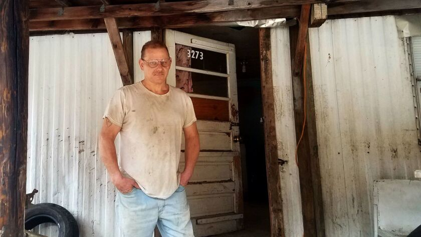 James Maynard, 50, a former truck driver who lives amid a narrow strip of ramshackle trailers in Lov