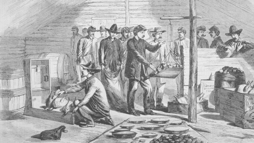 An engraving shows Union troops receiving Thanksgiving rations during the Civil War, circa 1864.