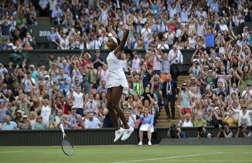 """United States' Cori """"Coco"""" Gauff celebrates after beating Slovenia's Polona Hercog in a Women's sing"""