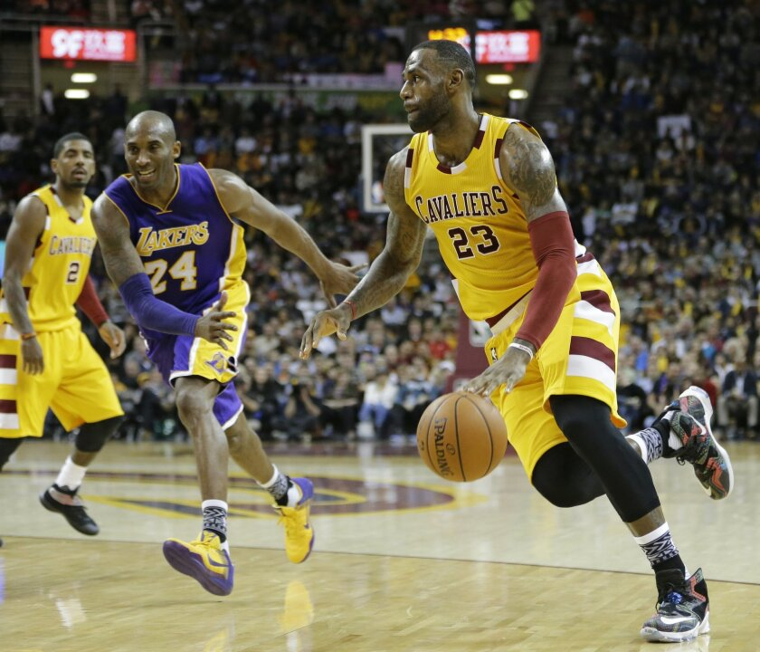 Cleveland Cavaliers' LeBron James (23) drives against Los Angeles Lakers' Kobe Bryant (24) in the second half of an NBA basketball game Wednesday, Feb. 10, 2016, in Cleveland. The Cavaliers won 120-111. (AP Photo/Tony Dejak)