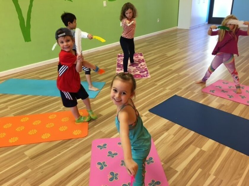 Children practice yoga at If I Was A Bird Yoga.