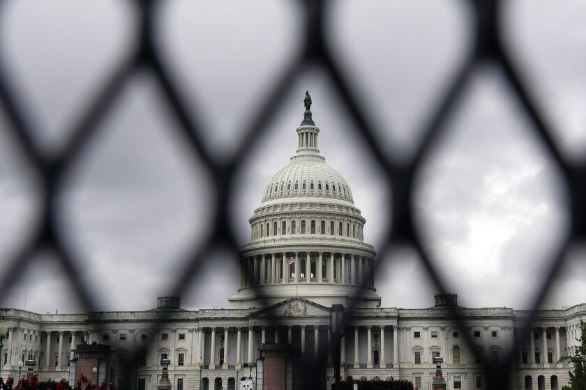"""Security fencing is seen around the Capitol in Washington, Friday, Sept. 17, 2021, ahead of a weekend rally planned by allies of former President Donald Trump that is aimed at supporting the so-called """"political prisoners"""" of the Jan. 6 insurrection at the U.S. Capitol. (AP Photo/Brynn Anderson)"""