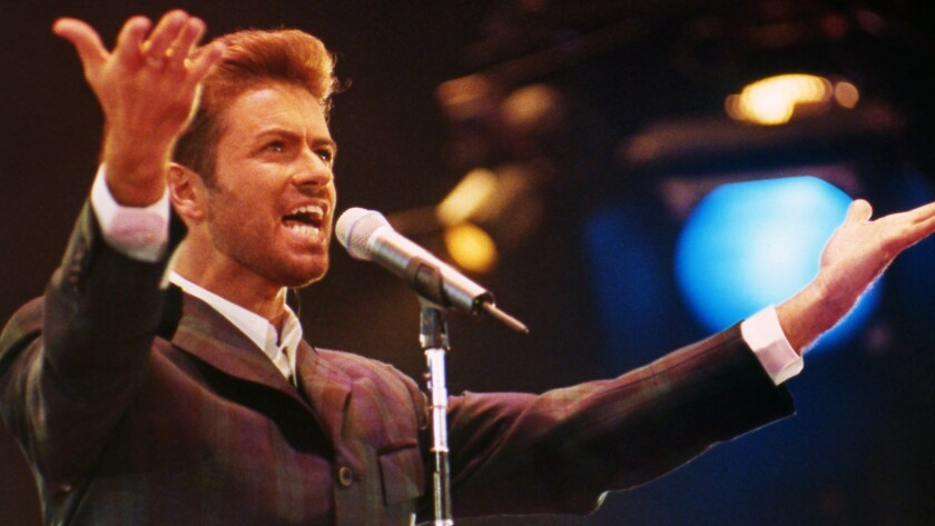 British singer George Michael performs in front of 11,000 people to mark World AIDS Day at London's Wembley Arena in 1993.